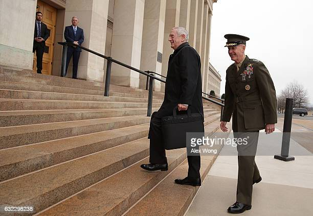 S Secretary of Defense James Mattis is greeted and escorted by Chairman of the Joint Chiefs of Staff General Joseph Dunford as he arrives for the...