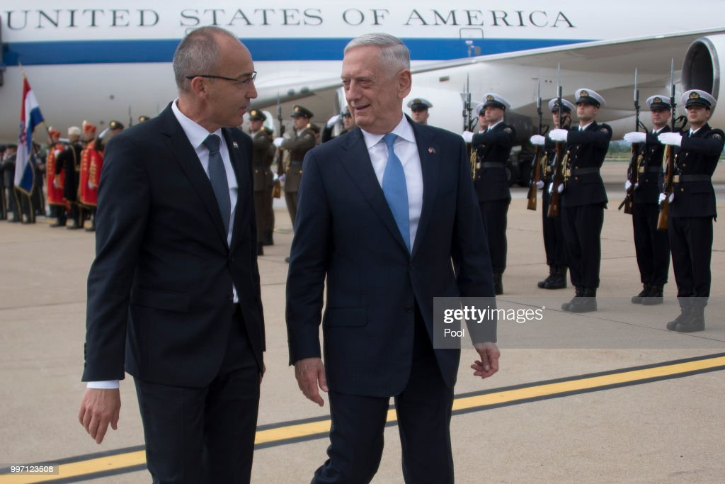 US Secretary of Defense James Mattis (R) is greeted by Croatian Minister of Defense Damir Krsticevic during a Welcoming Ceremony upon landing on July 12, 2018 in Zagreb, Croatia.