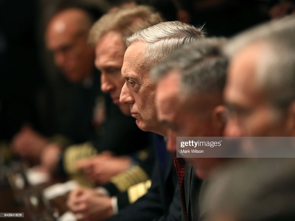 U.S. Secretary of Defense James Mattis (C), listens while President Donald Trump receives a briefing from senior military leaders regarding Syria, in the Cabinet Room, on April 9, 2018 in Washington, DC.