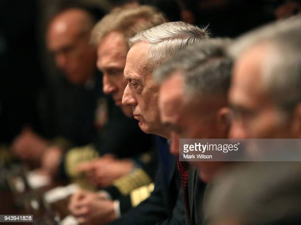 S Secretary of Defense James Mattis listens while President Donald Trump receives a briefing from senior military leaders regarding Syria in the...