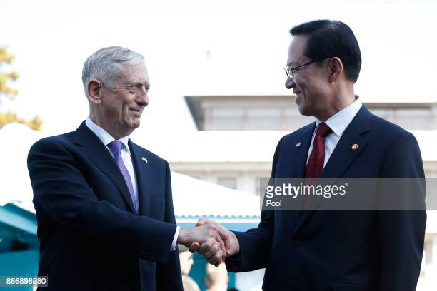 S Secretary of Defense James Mattis shakes hands with South Korean Defense Minister Song Youngmoo at the truce village of Panmunjom in the...