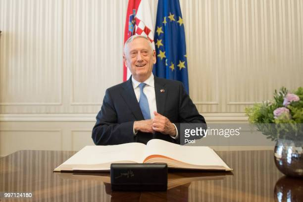 Secretary of Defense James Mattis signs a guest book before a meeting with Croatian Prime Minister Andrej Plenkovic on July 12 2018 in Zagreb Croatia