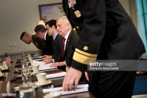 US Secretary of Defense James Mattis takes his seat for a meeting with Qatar's Emir Sheikh Tamim Bin Hamad AlThani at the Pentagon April 9 2018 in...