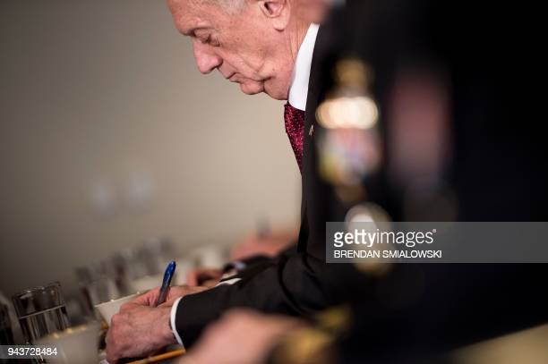 US Secretary of Defense James Mattis takes notes before a meeting with Qatar's Emir Sheikh Tamim Bin Hamad AlThani at the Pentagon April 9 2018 in...