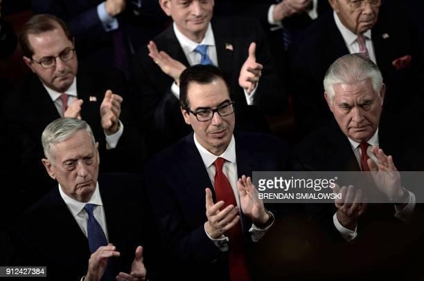 US Secretary of Defense James Mattis US Secretary of Treasury Steven Mnuchin and US Secretary of State Rex Tillerson clap as US President Donald...