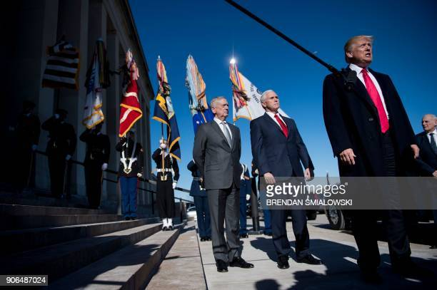 US Secretary of Defense James Mattis US Vice President Mike Pence and White House Chief of Staff John Kelly listen while US President Donald Trump...