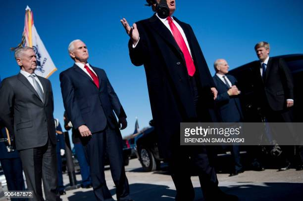 US Secretary of Defense James Mattis US Vice President Mike Pence White House Chief of Staff John Kelly and Pence Chief of Staff Nick Ayers listen as...
