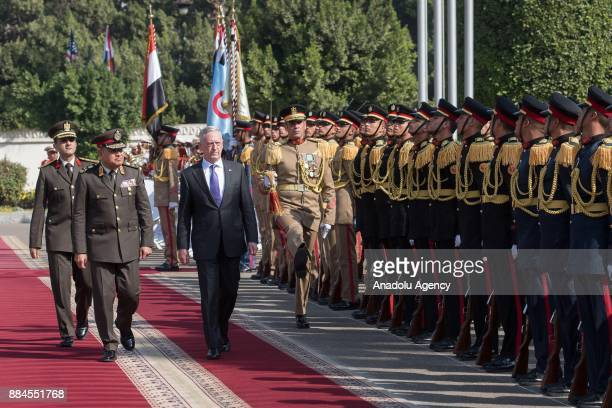 US Secretary of Defense James Mattis walks past the honour guards with Egyptian Defense Minister Gen Sedki Sobhi during an official welcoming...