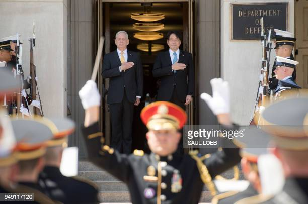 US Secretary of Defense Jim Mattis and Japanese Defense Minister Itsunori Onodera stand for the National Anthems as he arrives for meetings at the...