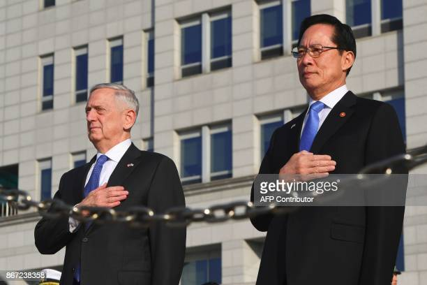 US Secretary of Defense Jim Mattis and South Korea's Defence Minister Song YoungMoo stand at attention during a welcoming ceremony at the Defence...