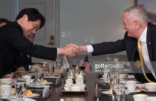 US Secretary of Defense Jim Mattis shakes hands with Japanese Defense Minister Itsunori Onodera during a meeting at the Pentagon in Washington DC...