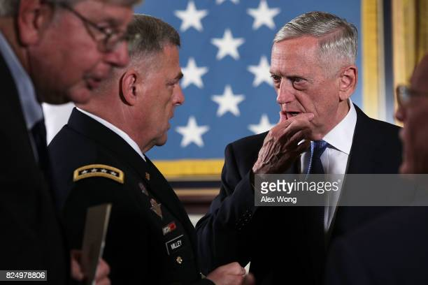 S Secretary of Defense Jim Mattis talks to Chief of Staff of the Army Mark A Milley prior to a Medal of Honor ceremony at the East Room of the White...