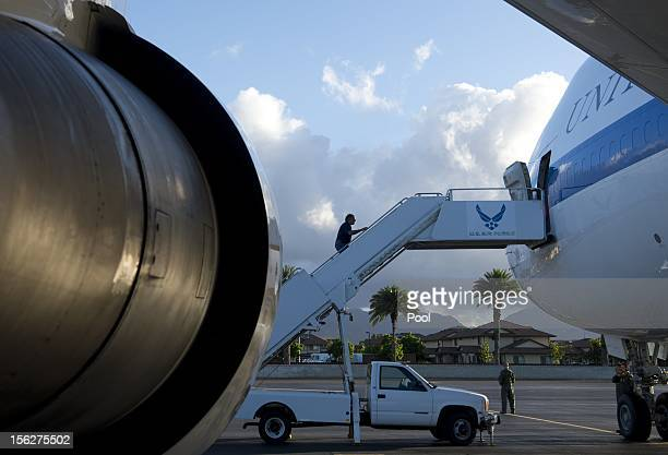 S Secretary of Defense Leon Panetta boards his airplane prior to departing Hickam Air Force Base on November 12 2012 in Honolulu Hawaii Panetta is...