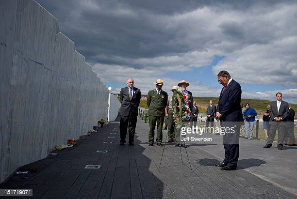 S Secretary of Defense Leon Panetta bows his head during wreathlaying ceremonies commemorating the eleventh anniversary of the 9/11 attacks as the...