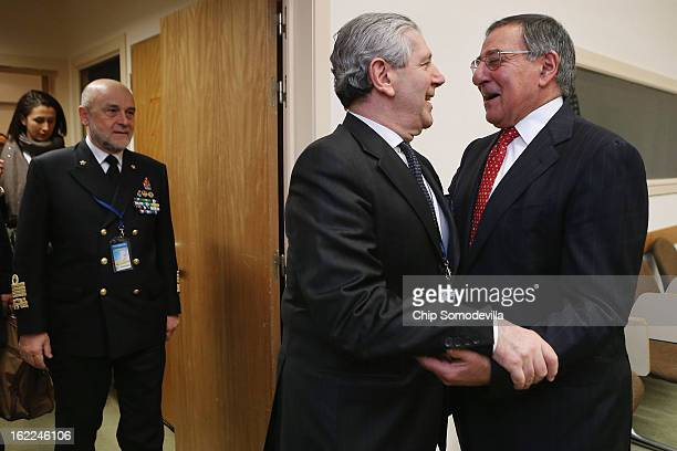 S Secretary of Defense Leon Panetta embraces Italy Defense Minister Giampaolo Di Paola before a meeting at the North Atlantic Treaty Organization...