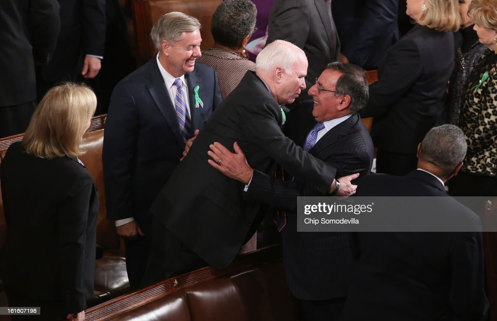 U.S. Secretary of Defense Leon Panetta greets Sen. John McCain (R-AZ) (C) and Sen. Lindsey Graham (R-SC) (L) before U.S. President Barack Obama's State of the Union address February 12, 2013 in Washington, DC. Facing a divided Congress, Obama concentrated his speech on new initiatives designed to stimulate the U.S. economy.