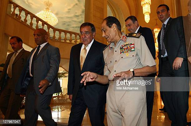 S Secretary of Defense Leon Panetta is escorted to a luncheon by Egyptian Field Marshal Mohamed Hussein Tantawi and Egyptian Prime Minister Essam...