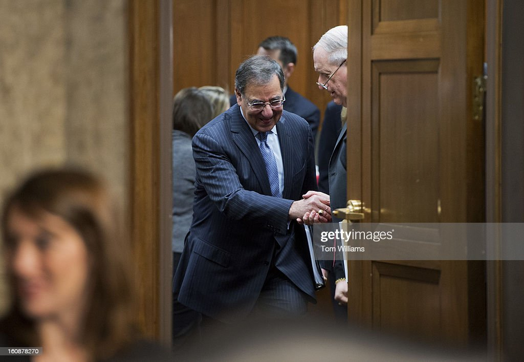 Secretary of Defense Leon Panetta, left, and Chairman Carl Levin, D-Mich., arrive for a Senate Armed Services Committee hearing featuring testimony by Panetta and Chairman of the Joint Chiefs of Staff Gen. Martin Dempsey, on the Defense Department's response to the attack on U.S. embassy in Benghazi, Libya, and discuss the findings of its internal review of the attack.