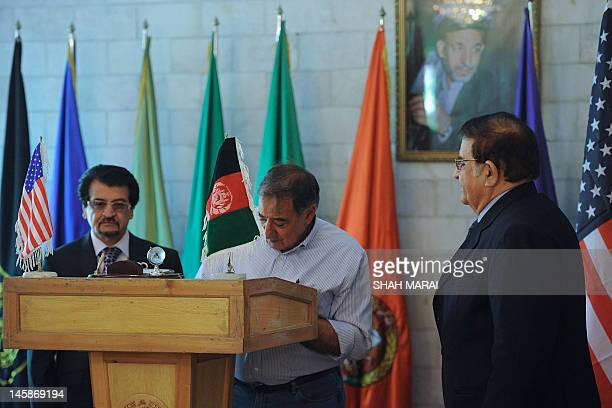 US Secretary of Defense Leon Panetta signs a guest book as Afghan Minister of Defence Abdul Rahim Wardak looks on prior to a meeting in Kabul on June...