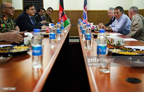 US Secretary of Defense Leon Panetta sits with US Ambassador to Afghanistan Ryan Crocker and Commander of International Secerity Assistance Force...