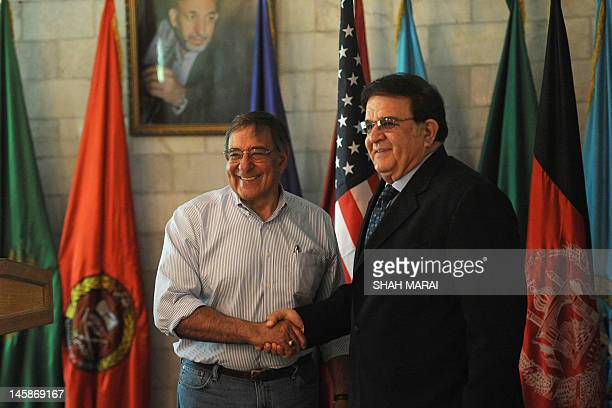 US Secretary of Defense Leon Panetta smiles as he shakes hands with Afghan Minister of Defence Abdul Rahim Wardak prior to a meeting in Kabul on June...
