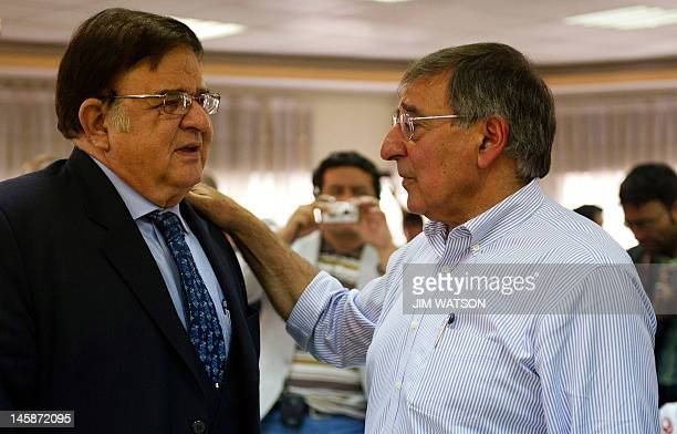 US Secretary of Defense Leon Panetta speaks with Afghanistan Defence Minister General Abdul Rahim Wardak after a joint press conference at the...
