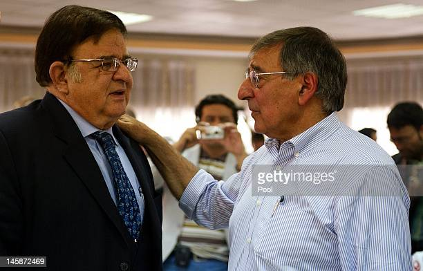 Secretary of Defense Leon Panetta speaks with Afghanistan Defense Minister General Abdul Rahim Wardak after a joint press conference at the Ministry...