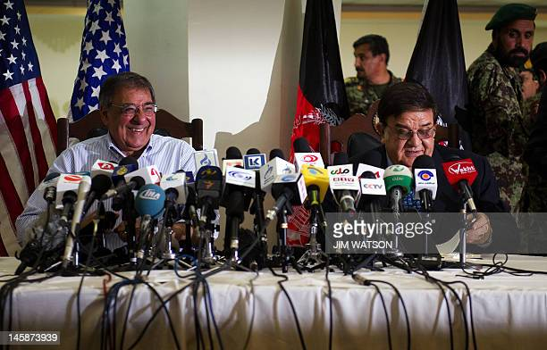 US Secretary of Defense Leon Panetta speaks with Afghanistan Defense Minister General Abdul Rahim Wardak during a joint press conference at the...