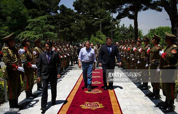 US Secretary of Defense Leon Panetta walks through an honour cordon with Afghan Defence Minister General Abdul Rahim Wardak as he arrives at the...