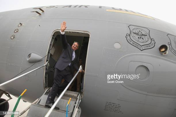 S Secretary of Defense Leon Panetta waves as he prepares to leave Afghanistan on March 15 2012 in Kabul Afghanistan Panetta visited with troops and...