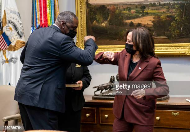 Secretary of Defense Lloyd Austin elbow bumps with U.S. Vice President Kamala Harris during his ceremonial swearing-in ceremony in the Roosevelt Room...