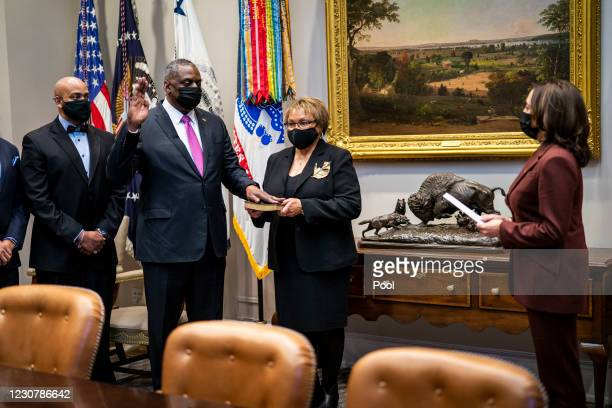 Secretary of Defense Lloyd Austin participates in a ceremonial swearing-in with U.S. Vice President Kamala Harris in the Roosevelt Room of the White...