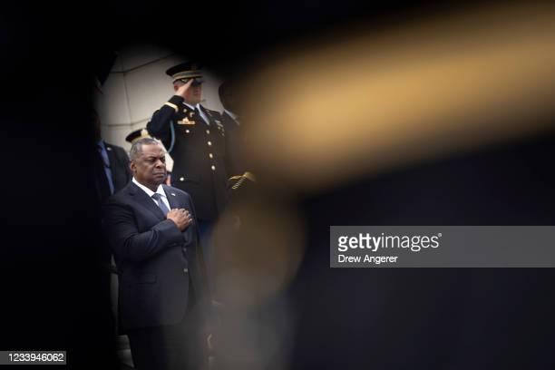 Secretary of Defense Lloyd Austin places his hand over his heart as he participates in a wreath laying ceremony with Robert Ben Wallace, Secretary of...