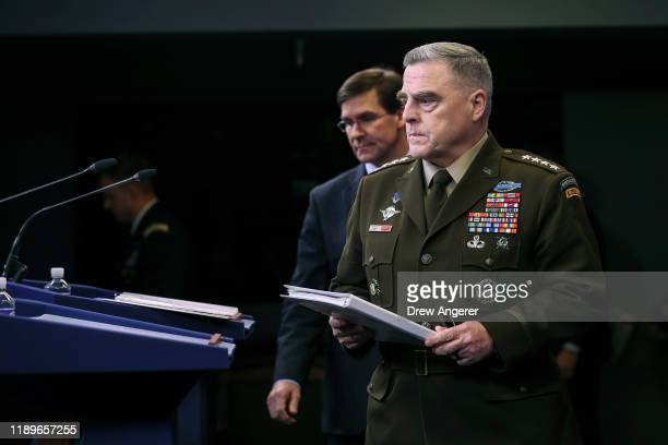 Secretary of Defense Mark Esper and Chairman of the Joint Chiefs of Staff Army Gen Mark Milley arrives for an end of year press conference at the...