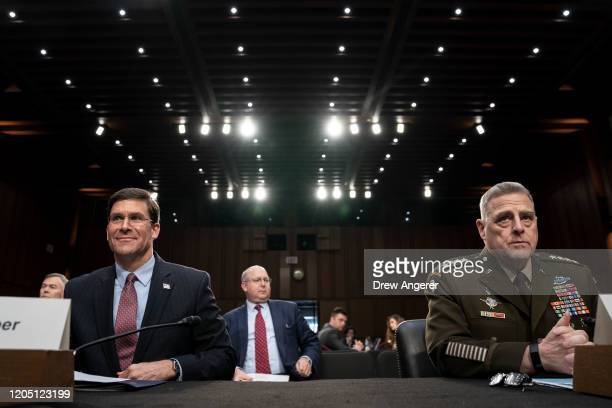 US Secretary of Defense Mark Esper and Chairman of the Joint Chiefs of Staff Mark Milley take their seats as they arrive for a Senate Armed Services...