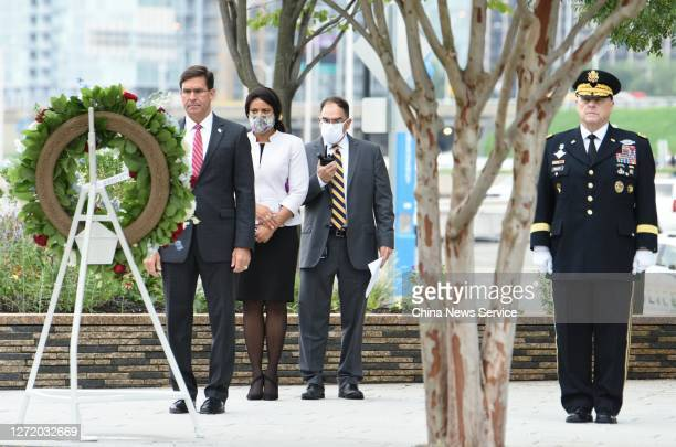 Secretary of Defense Mark Esper and Chairman of the Joint Chiefs of Staff Mark Milley pay their respects to 9/11 victims during a 9/11 memorial...