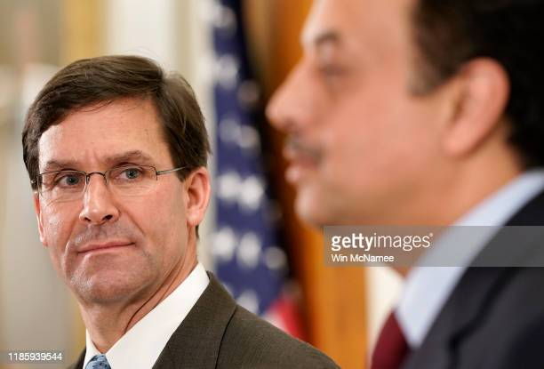 S Secretary of Defense Mark Esper answers questions briefly with Qatari Minister of State for Defense Affairs Khalid AlAttiyah at the Pentagon...