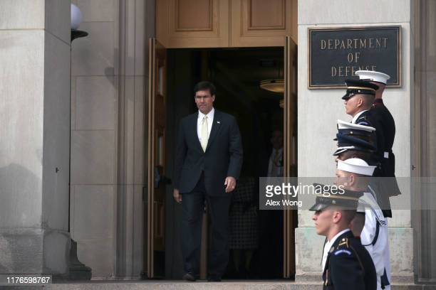 S Secretary of Defense Mark Esper comes out from the building to welcome Germany Defense Minister Annegret KrampKarrenbauer during an enhanced honor...