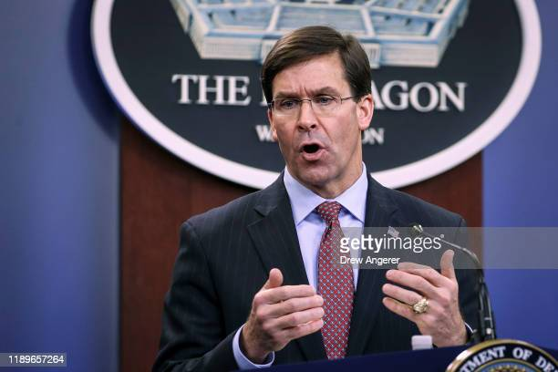 Secretary of Defense Mark Esper holds an end of year press conference at the Pentagon on December 20 2019 in Arlington Virginia Esper and Milley...