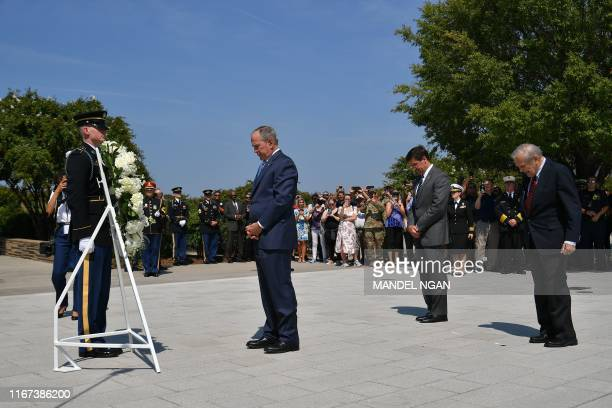 US Secretary of Defense Mark Esper hosts a wreath laying ceremony with former US President George W Bush and former Secretary of Defense Donald...