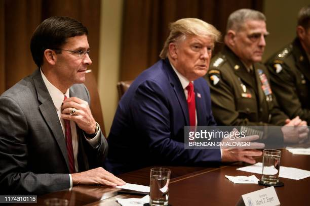 US Secretary of Defense Mark Esper US President Donald Trump and Chairman of the Joint Chiefs of Staff Army General Mark A Milley wait for a meeting...