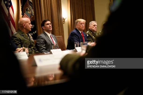 US Secretary of Defense Mark Esper US President Donald Trump Chairman of the Joint Chiefs of Staff Army General Mark A Milley and others wait for a...