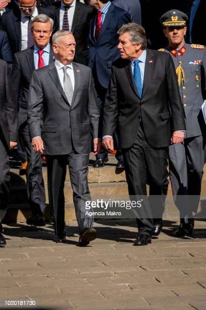 Minister of Defense of Chile Alberto Espina and Secretary of Defense of the United States James Mattis shake hands at the end of a press conference...
