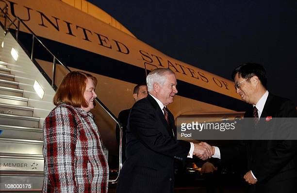 S Secretary of Defense Robert Gates and his wife Becky are welcomed by Japan's DirectorGeneral of the Foreign Ministry Kazuyoshi Umemoto at Haneda...