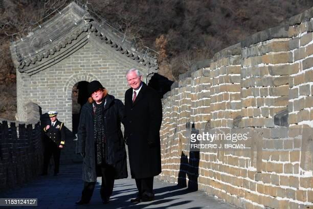 US Secretary of Defense Robert Gates and his wife Becky pose for pictures during a visit the Great Wall at Mutianyu on the outskirts of Beijing on...