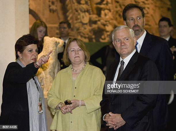 US Secretary of Defense Robert Gates his wife Becky Gates and US Ambassador to Mexico Tony Garza listen to a guide during a visit to the National...