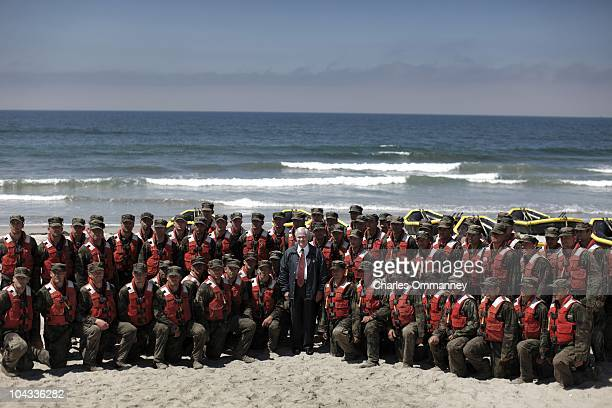 Secretary of Defense Robert Gates poses with Navy Seal recruits at the end of 'Hell week' at the Naval Special warfare center August 13 2010 in...