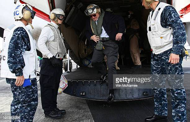 S Secretary of Defense Robert Gates steps off a COD plane as he arrives aboard the USS Abraham Lincoln December 6 2010 in the Arabian Sea Gates...
