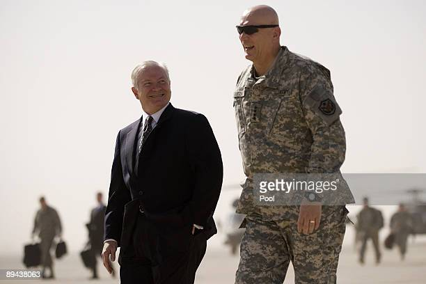 US Secretary of Defense Robert Gates walks to his plane with US commander in Iraq General Ray Odierno as he prepares to depart Baghdad on June 29...