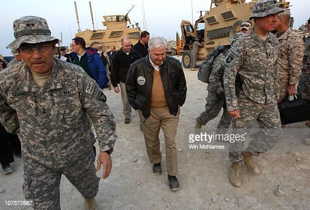 S Secretary of Defense Robert Gates walks with Major Gen John Campbell Commanding General of the 101st Air Assault in Kunar Province December 7 2010...